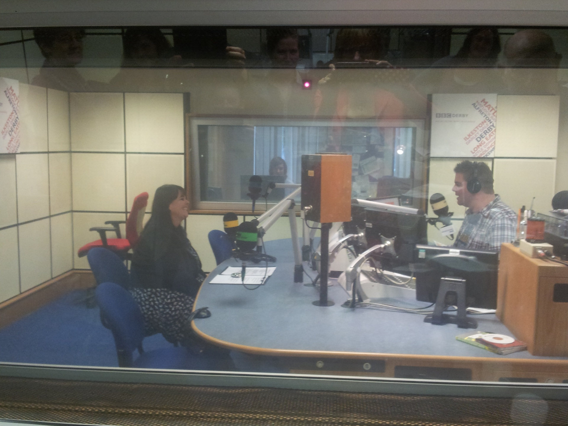 Tracey Wilkinson giving the inside story of the Song for Belper to Ian Skye at Radio Derby